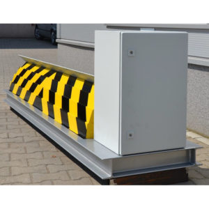 Hydraulic road blocker with drive unit